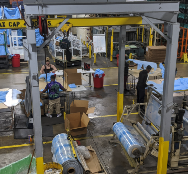 plant workers making medical gowns
