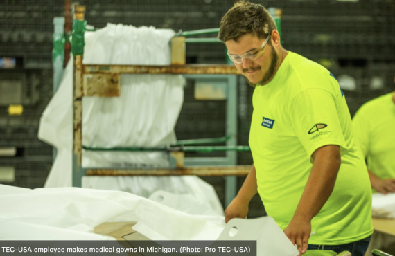 Factory worker in bright green shirt working on EZDoff medical gowns